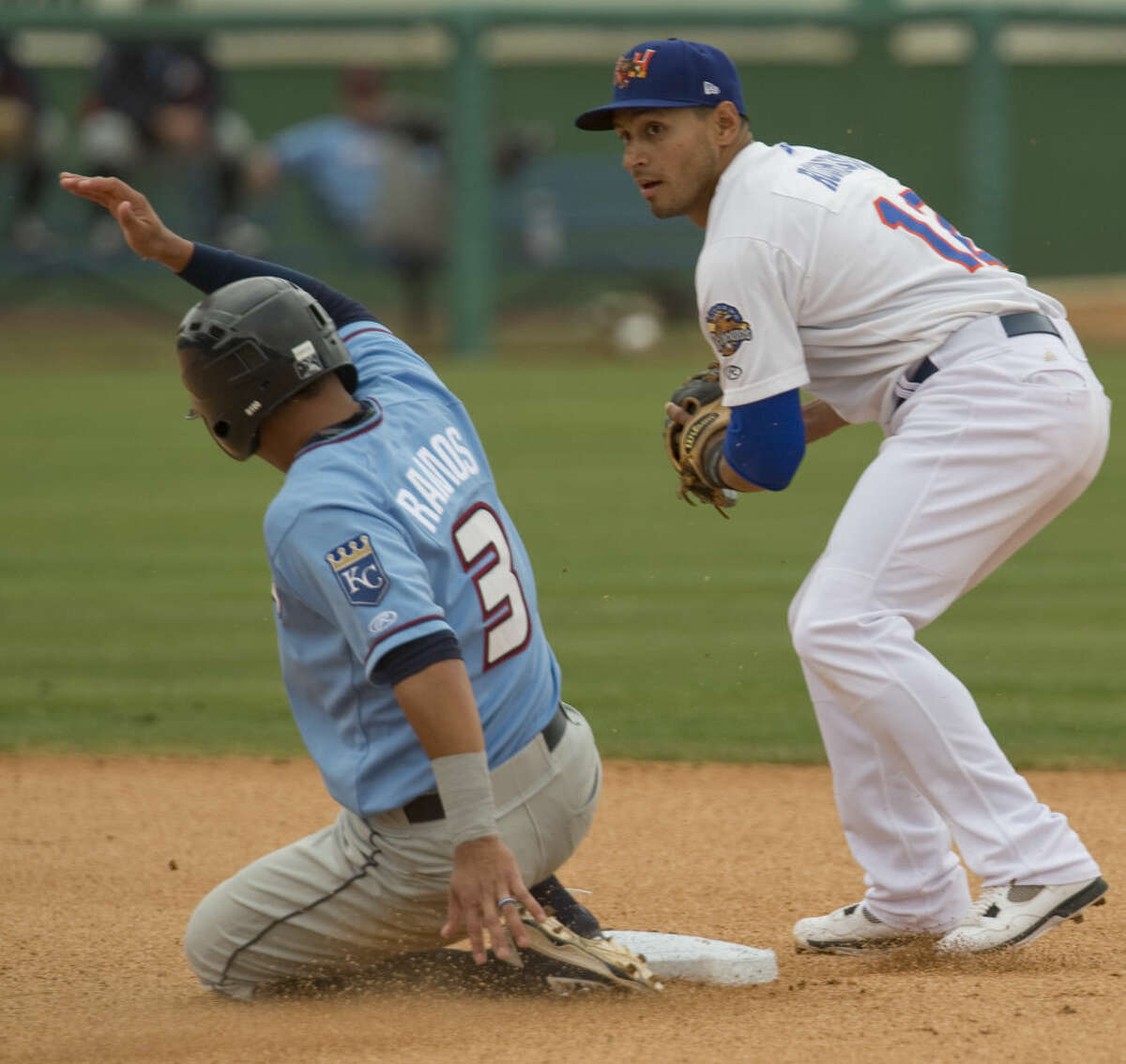 RockHounds' Josh Rodriguz gets the force out on Arkansas' Mauricio Ramos at second but can not make the play at first to complete the double play Tuesday 04-19-16 at Security Bank Ballpark. Tim Fischer\Reporter-Telegram