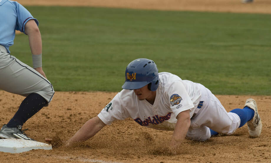 RockHounds' Wade Kirkland safely dives back to first as Arkansas first baseman Frank Schwindel waits on the ball Tuesday 04-19-16 at Security Bank Ballpark. Tim Fischer\Reporter-Telegram Photo: Tim Fischer