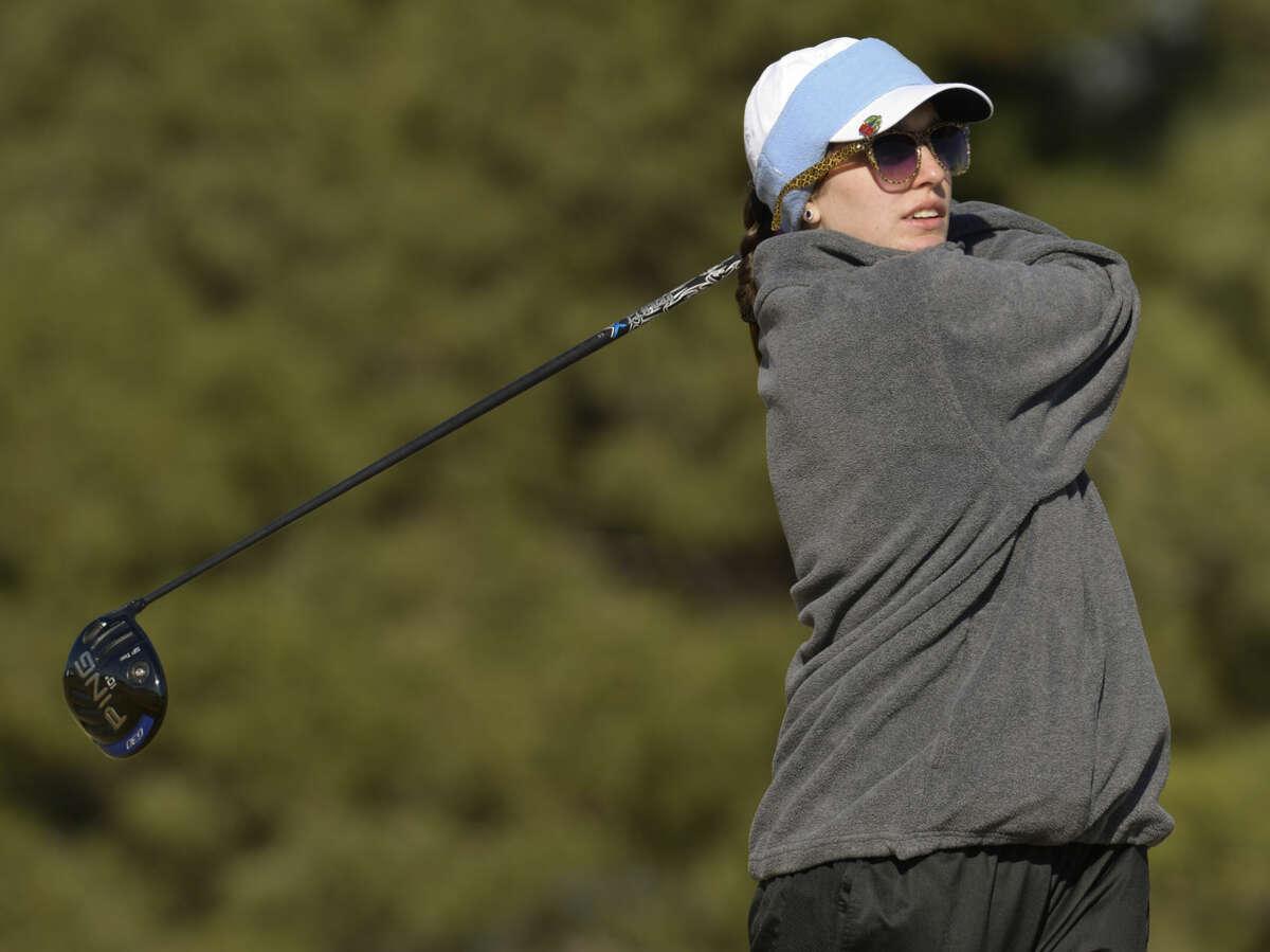 Midland Christian's Blaire Neatherlin watches her shot Friday 02-26-16 at the Girls Tall City Golf Invitational. Tim Fischer/Reporter-Telegram