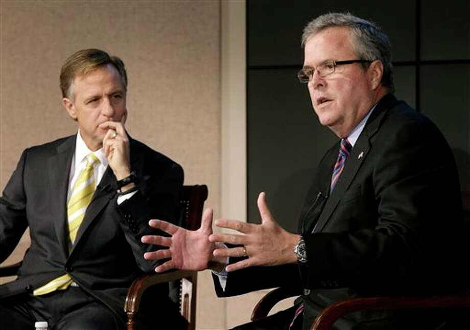 FILE - This Jan. 14, 2013 file photo shows former Florida Gov. Jeb Bush, right, and Tennessee Gov. Bill Haslam talking about education reform during a forum in Nashville, Tenn. More than five years after governors from both major parties began a mostly quiet effort to set new standards in American schools, the so-called Common Core initiative has morphed into a political tempest that fuels division among Republicans. Bush hails Common Core as a way to improve student performance and, over the long term, competitiveness of American workers. (AP Photo/Mark Humphrey, File) Photo: Mark Humphrey / AP2013