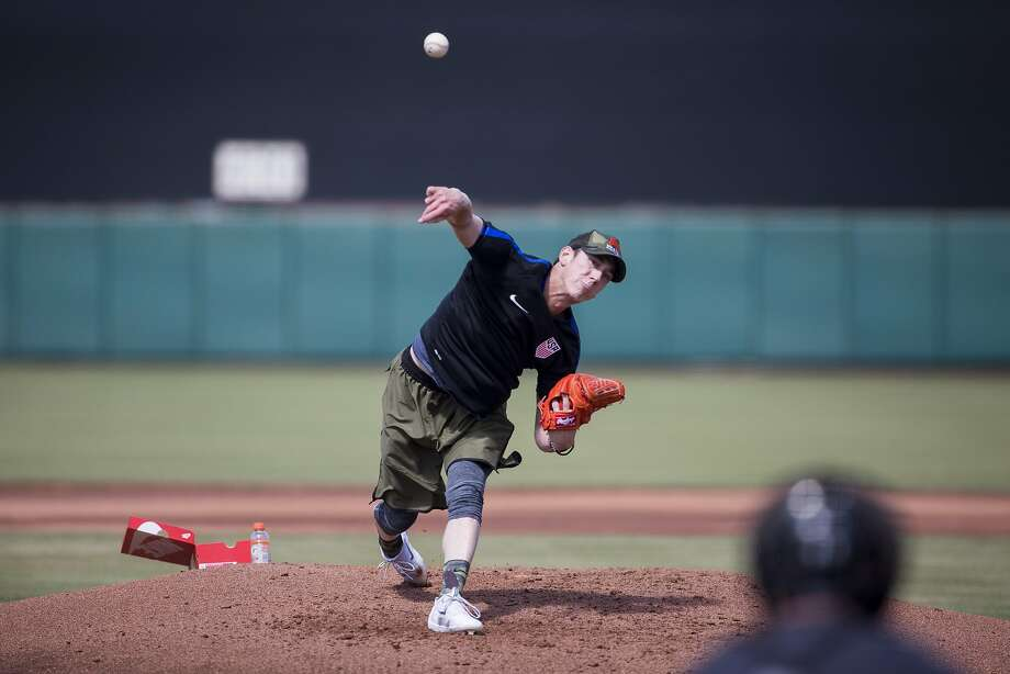 Former San Francisco Giants pitcher Tim Lincecum pitches during a showcase May 6 at Scottsdale Stadium in Scottsdale, Ariz. Photo: Caitlin O'Hara, Special To The Chronicle