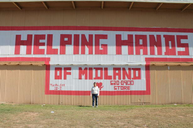 Mary Hardin, executive director of Helping Hands, stands outside the nonprofit's building.