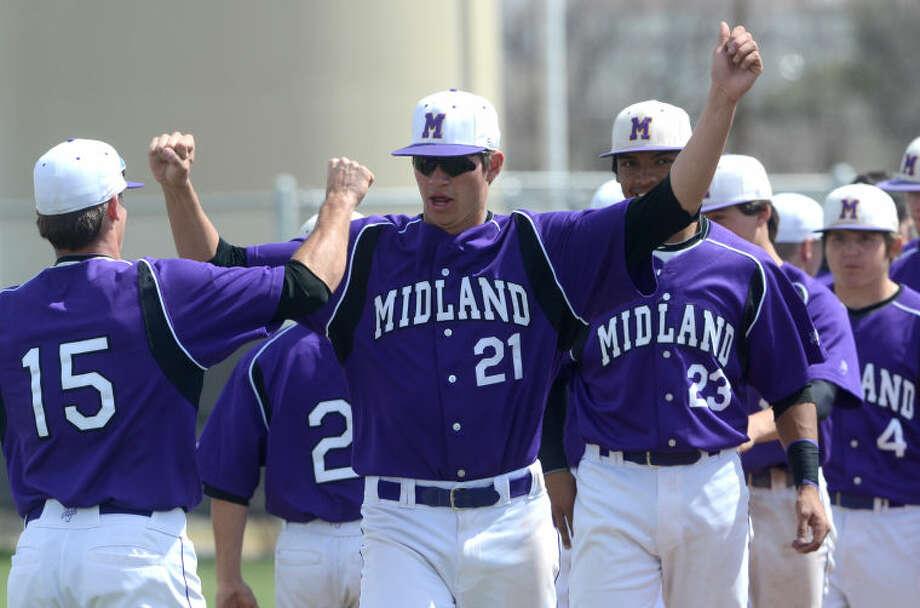 Midland High baseball players celebrate a win against Abilene Cooper on Saturday at Zachery Field. James Durbin/Reporter-Telegram Photo: JAMES DURBIN