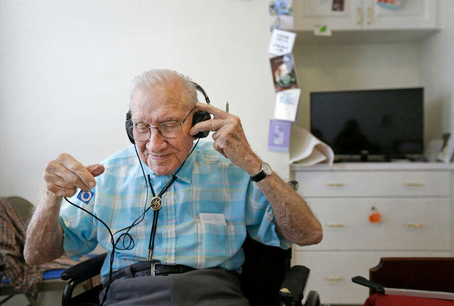Walter Jones talks about his enjoyment of music Friday, April 15, 2016, at Holly Hall, 2000 Holly Hall St., in Houston. Last year, the state piloted a program that uses music to help aid the memory of nursing home residents. Three Houston facilities, including Holly Hall, were part of the program. Participates listen to music on an iPod Shuffle. He also has a collection of Big Band cassette tapes and a player in his room. ( Melissa Phillip / Houston Chronicle )