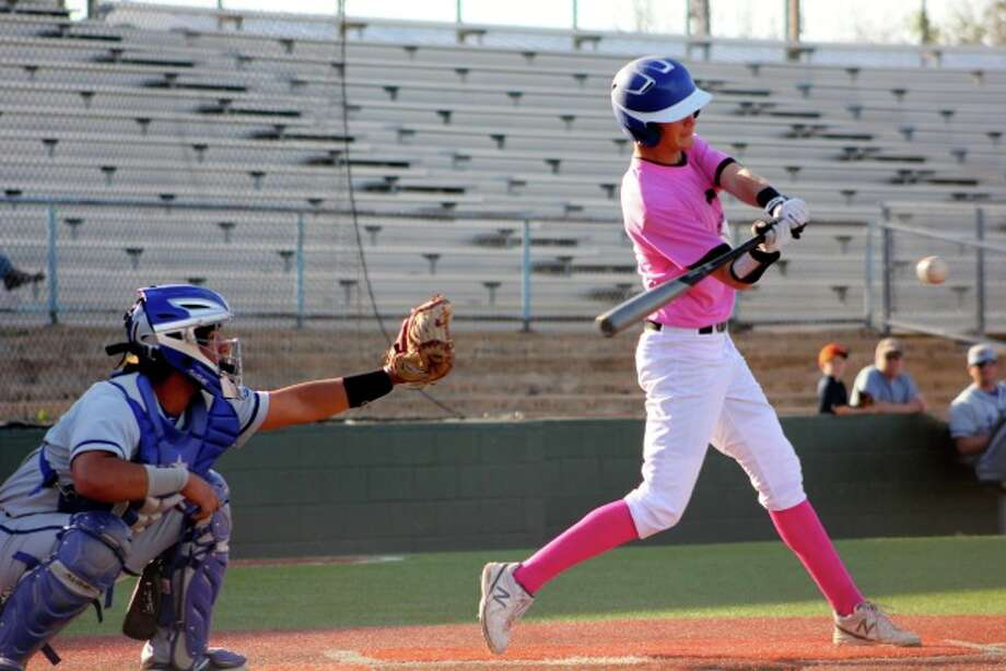 Midland Christian's Korey Rasure hits during Monday's game against Lubbock Christian. The Mustangs had a Pink Out game on Monday for breast cancer awareness.Kelsie Rasure Photo