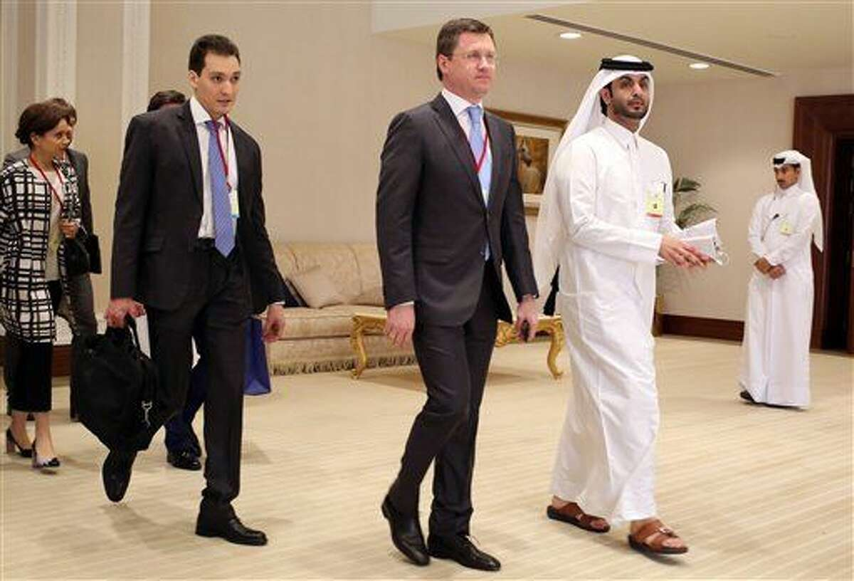 Russian Energy Minister Russian Energy Minister Alexander Novak, center, arrives at an oil-producers' meeting in Doha, Qatar, on Sunday, April 17, 2016. Oil-producing countries are meeting in Qatar to discuss a possible freeze of production to counter low global prices, but Iran's last-minute decision to stay home could dilute the impact of any agreement. (AP Photo/Jon Gambrell)