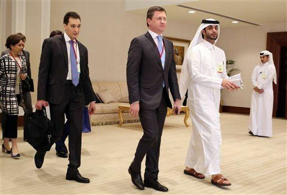 Russian Energy Minister Russian Energy Minister Alexander Novak, center, arrives at an oil-producers' meeting in Doha, Qatar, on Sunday, April 17, 2016. Oil-producing countries are meeting in Qatar to discuss a possible freeze of production to counter low global prices, but Iran's last-minute decision to stay home could dilute the impact of any agreement. (AP Photo/Jon Gambrell) Photo: Jon Gambrell