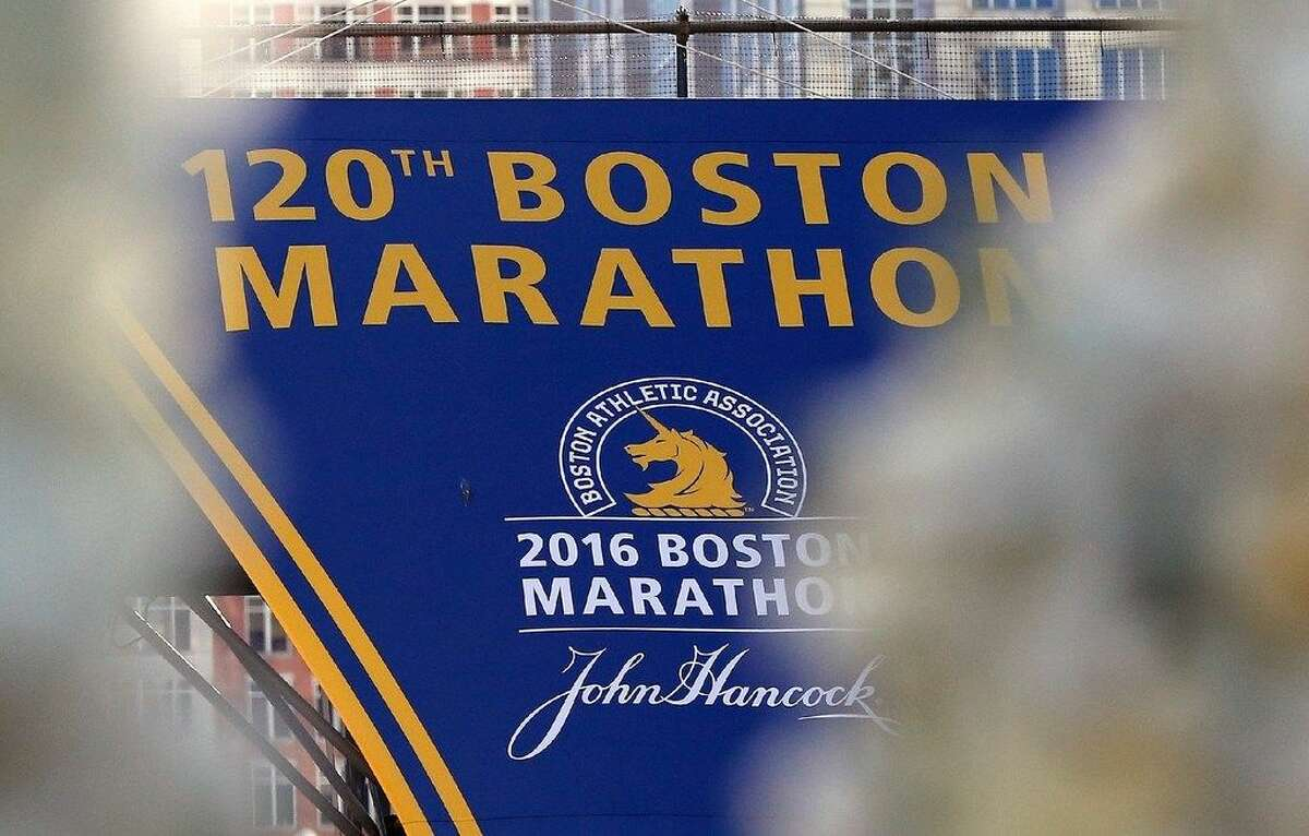 A banner at the finish line is seen through memorial wreaths before ceremonies marking the third anniversary of theBostonMarathonbombings, Friday, April 15, 2016, inBoston. Throughout the day, residents will be taking part in blood drives, food and clothing collections and other community service projects as the city has proclaimed April 15