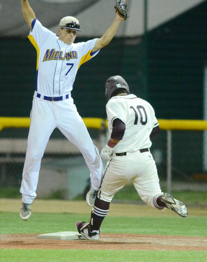 Lee High's Hunter Coleman (10) beats Midland High's Sam Bertleson (7) to first base on Friday, April 10, 2015 at Christensen Stadium. James Durbin/Reporter-Telegram Photo: James Durbin