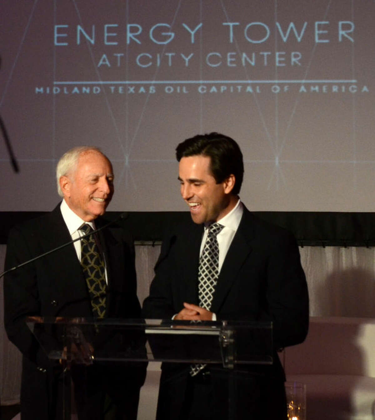 Bill and William Meyer, partners of energy-related properties, talk during the April 2013 Energy Tower press conference and reception at Midland Center. James Durbin/Reporter-Telegram