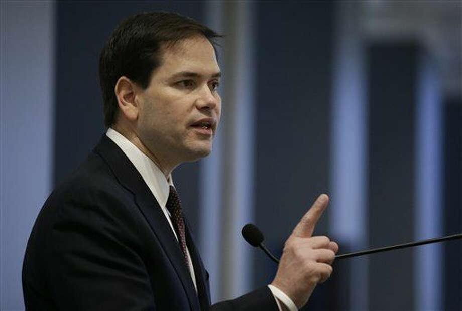 In this April 28, 2015, photo, Republican presidential hopeful Sen. Marco Rubio, R-Fla., speaks at an event organized by Town Hall Los Angeles in Los Angeles. Republicans are bringing something unique to the 2016 presidential campaign: an ability to speak to Americans in both of their main mother tongues, Spanish as well as English. It remains to be seen how much Jeb Bush and Rubio will use their fluent Spanish in the campaign. (AP Photo/Jae C. Hong) Photo: Jae C. Hong