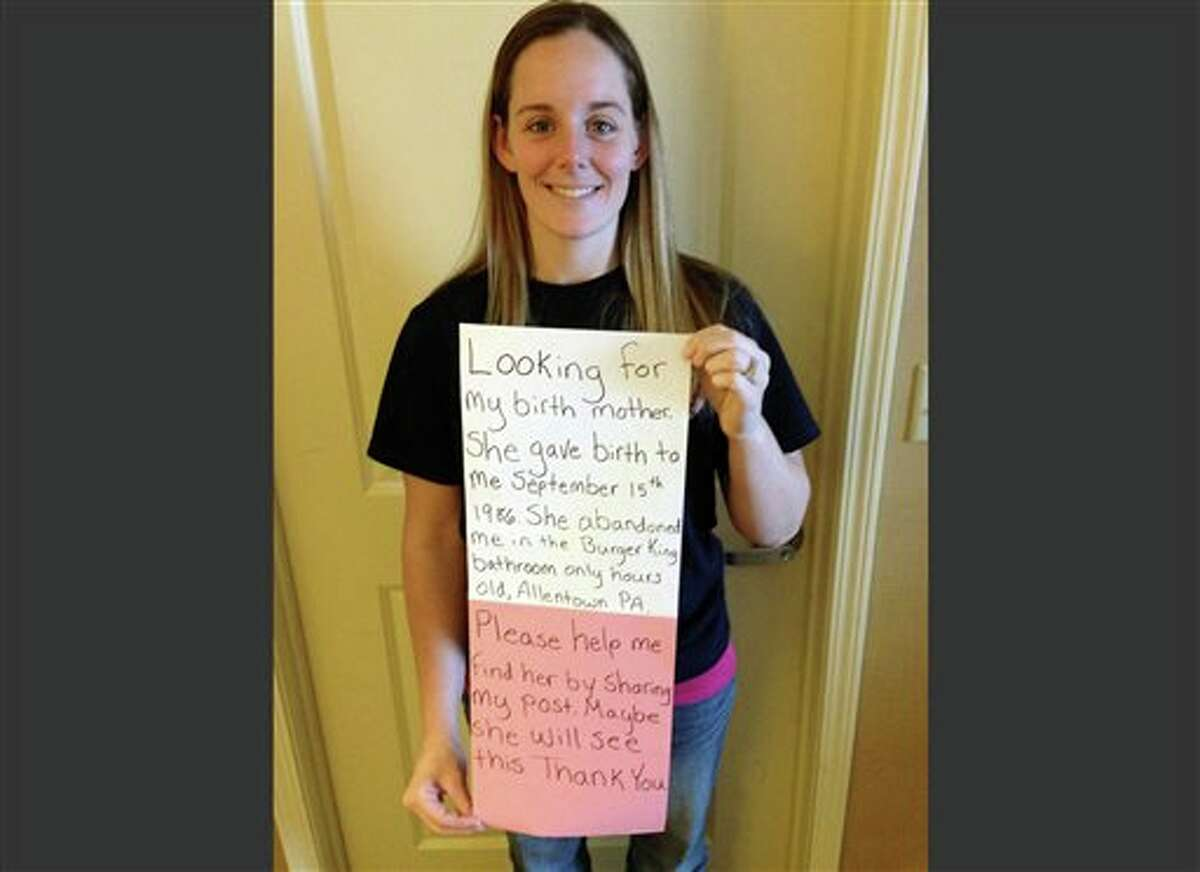 FILE - This March 2, 2014, file photo, provided by Katheryn Deprill that she posted on Facebook, shows Deprill holding a sign that says she is seeking her birth mother. Deprill was abandoned in the bathroom of a Burger King restaurant in Allentown, Pa., when she was a few hours old. Deprill tells The Associated Press that she met her biological mother for the first time Monday, March 24, 2014, in an attorney's office. Deprill said Tuesday that she felt