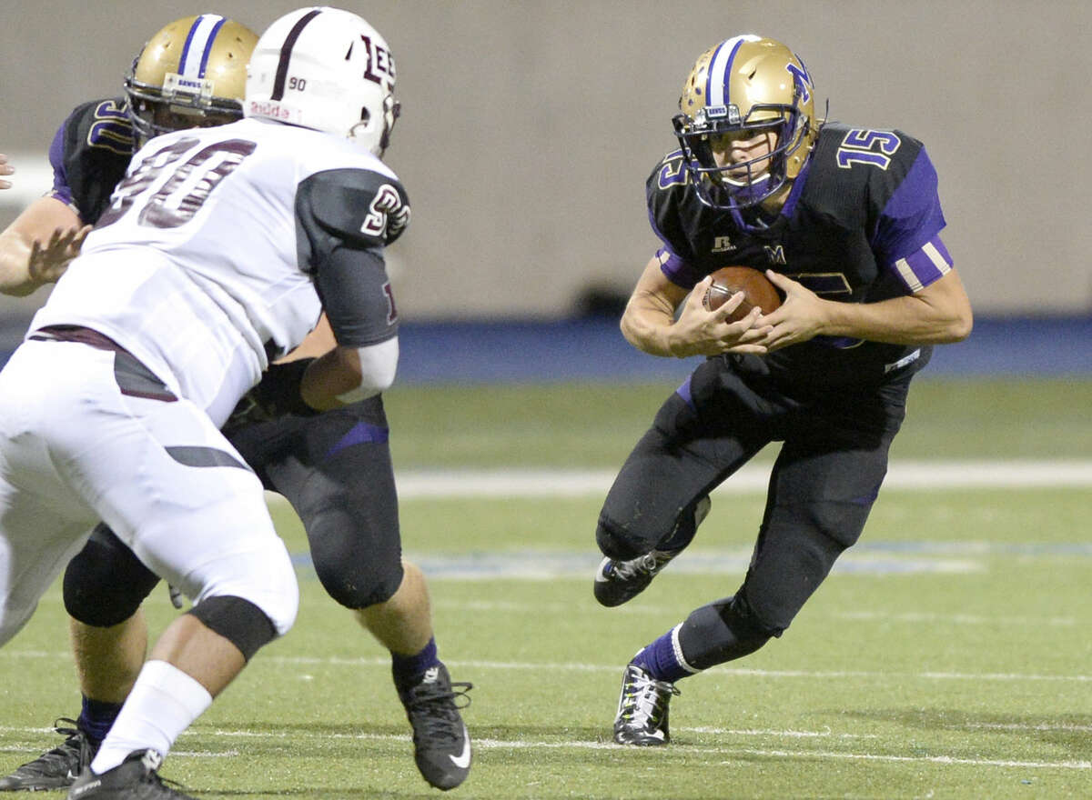 Midland High quarterback Jackson Anuszkiewicz (15) runs the ball on Friday, Nov. 6, 2015, at Grande Communications Stadium. James Durbin/Reporter-Telegram