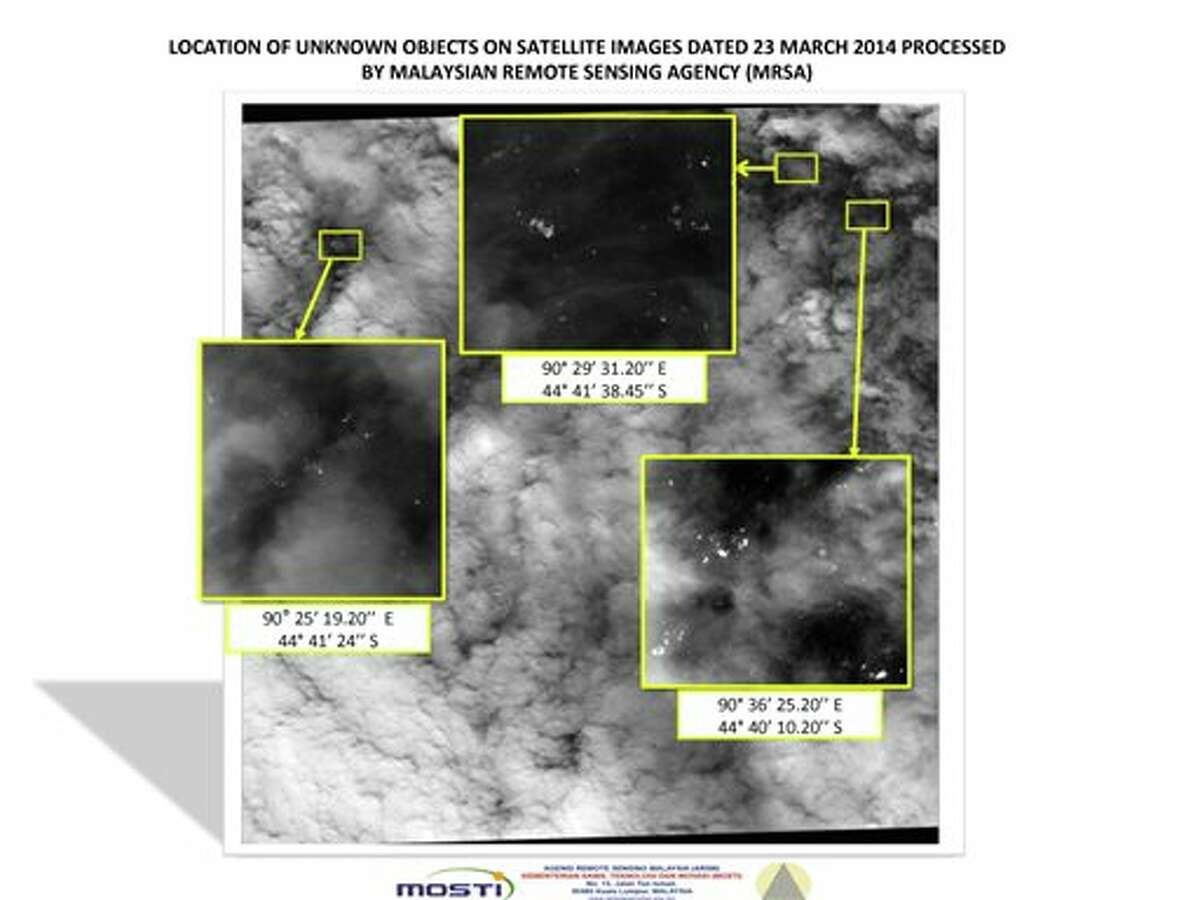 This graphic released by the Malaysian Remote Sensing Agency on Wednesday March 26, 2014, shows satellite imagery taken on March 23, 2014, with the approximate positions of objects seen floating in the southern Indian Ocean in the search zone for the missing Malaysia Airlines Flight 370. Malaysian Defense Minister Hishammuddin Hussein said at a news conference in Kuala Lumpur Wednesday that a satellite has captured images of 122 objects close to where three other satellites previously detected objects. (AP Photo/Malaysian Remote Sensing Agency)
