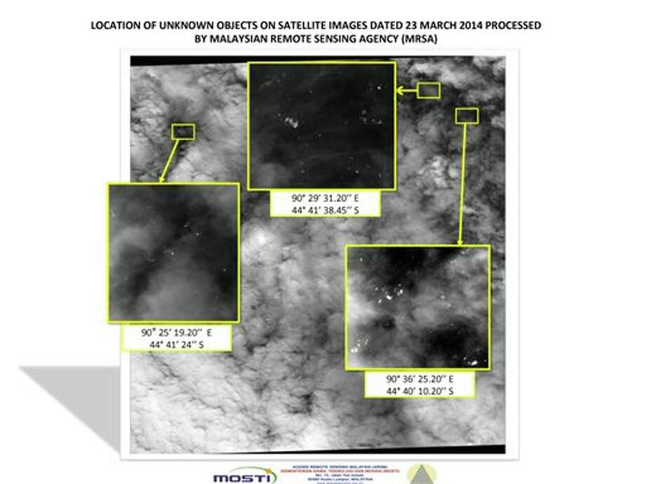This graphic released by the Malaysian Remote Sensing Agency on Wednesday March 26, 2014, shows satellite imagery taken on March 23, 2014, with the approximate positions of objects seen floating in the southern Indian Ocean in the search zone for the missing Malaysia Airlines Flight 370. Malaysian Defense Minister Hishammuddin Hussein said at a news conference in Kuala Lumpur Wednesday that a satellite has captured images of 122 objects close to where three other satellites previously detected objects. (AP Photo/Malaysian Remote Sensing Agency) Photo: Uncredited / AP2014