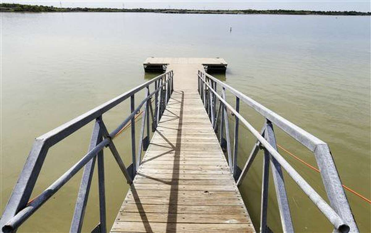 This April 10, 2015 photo shows Lavon Lake at East Fork park in Lavon, Texas. Lavon Lake is more than 80 percent full. Most lakes in the Dallas-Fort Worth area have been well below capacity since shortly after 2011, the state's driest-ever year. (Vernon Bryant/The Dallas Morning News via AP) MANDATORY CREDIT; MAGS OUT; TV OUT; INTERNET USE BY AP MEMBERS ONLY; NO SALES