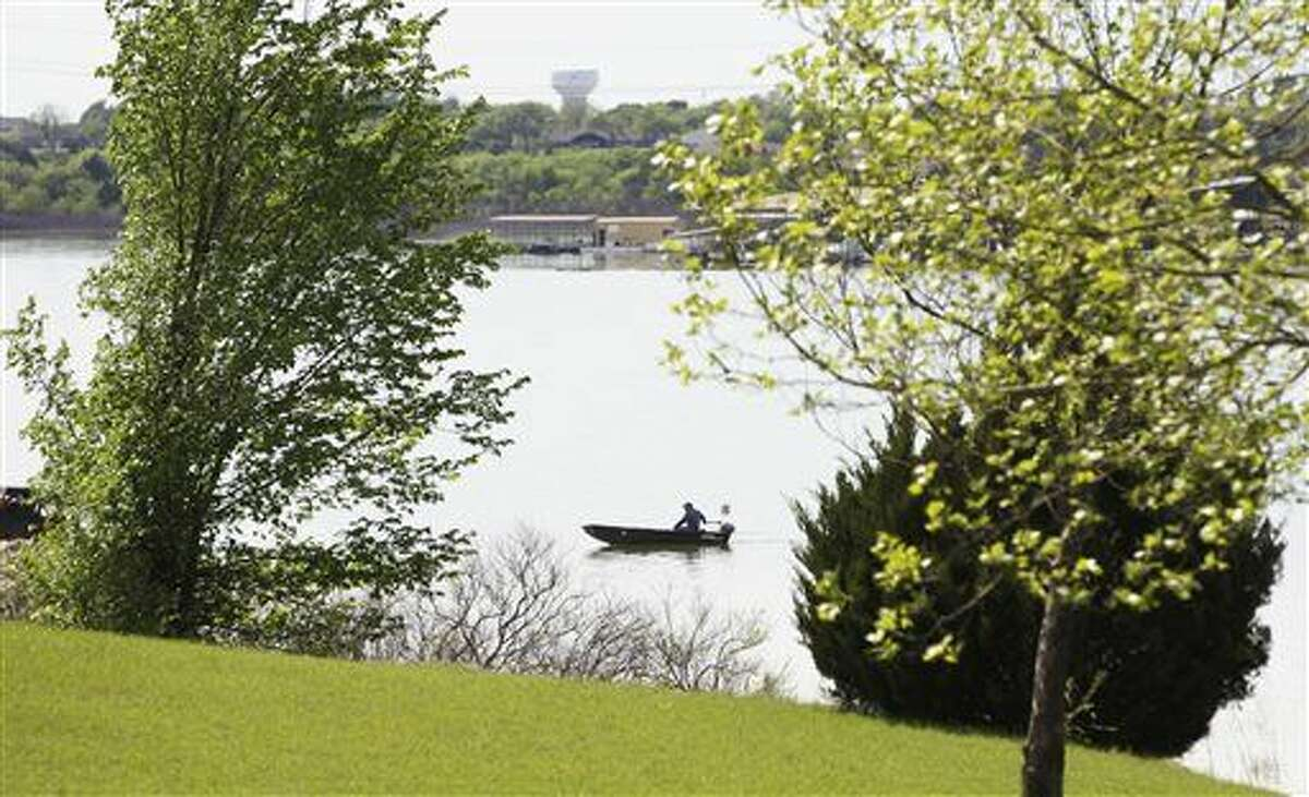 A fisherman moves down Lavon Lake at East Fork park on Friday, April 10, 2015 in Lavon, Texas. Most lakes in the Dallas-Fort Worth area have been well below capacity since shortly after 2011, the state's driest-ever year.
