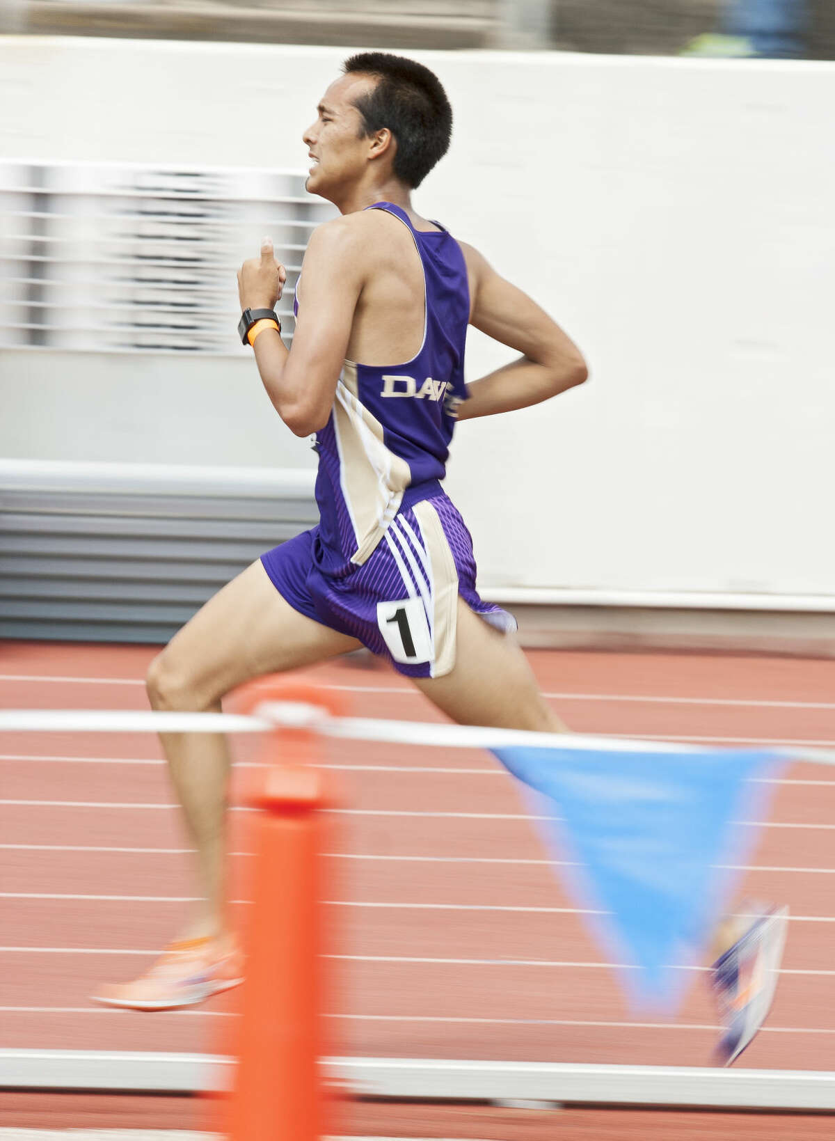 Midland junior Ruben Guerra runs along the track in the 3200M run during the UIL Region I-6A Track and Field Championship on Friday at Maverick Stadium in Arlington.