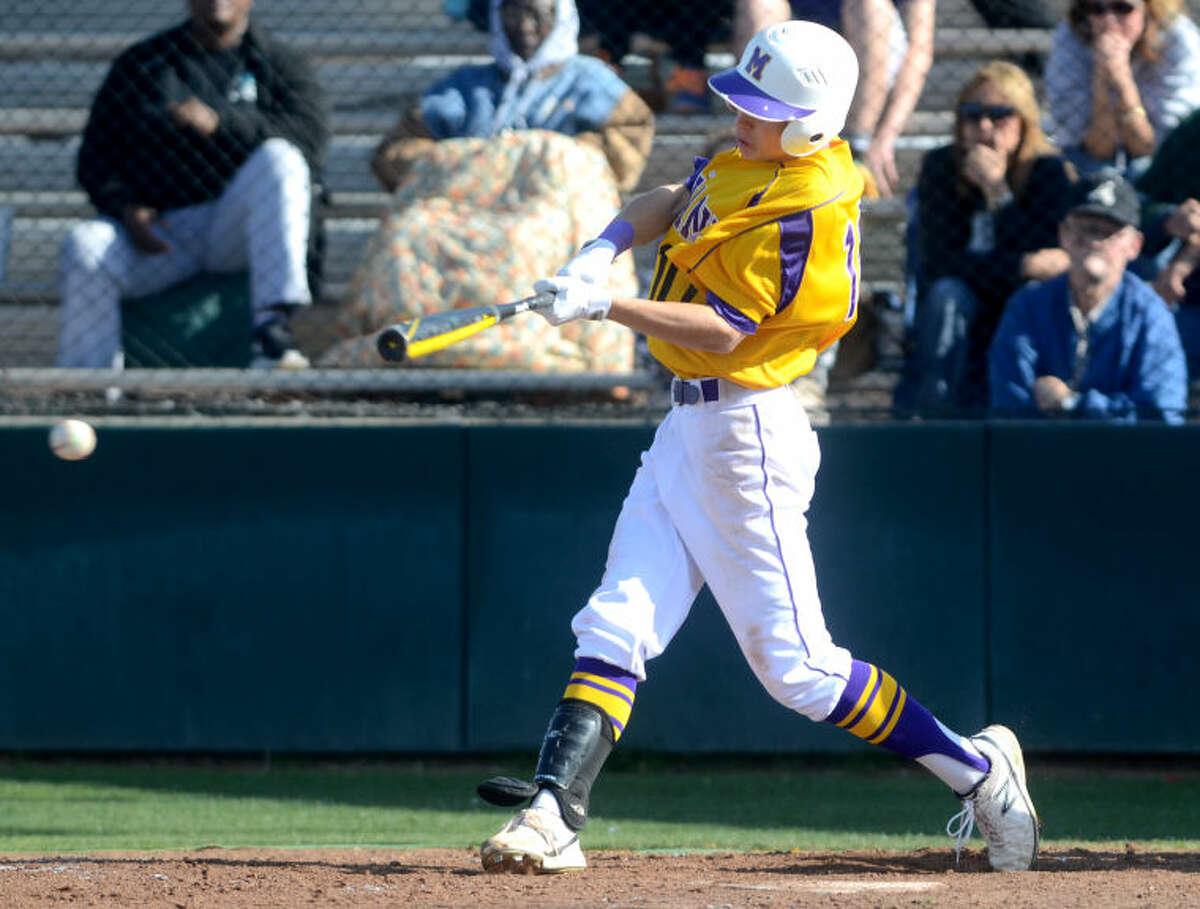 Midland High's Ethan Barker puts the ball in play against Abilene High on Tuesday at Zachery Field. James Durbin/Reporter-Telegram