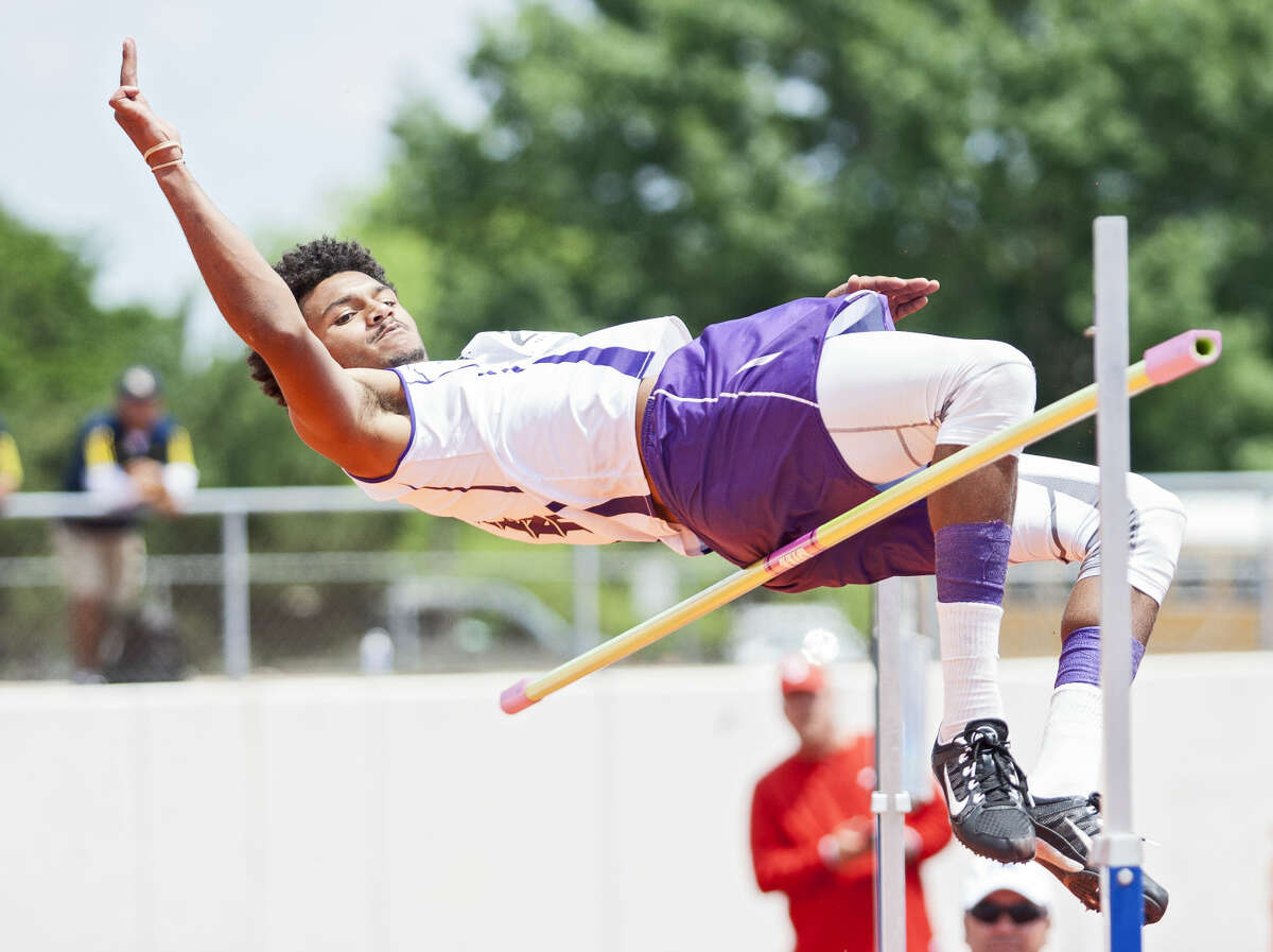 Midland sophomore Courtney McMaryion jumps over the bar in the high competition during the UIL 6A Region 1/5A Region 2 Track and Field Championship on Saturday at Maverick Stadium in Arlington. McMaryion finished in fourth place after clearing the 6-07 bar.