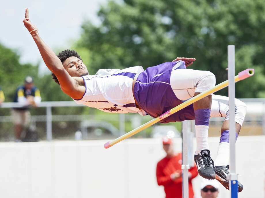 Midland sophomore Courtney McMaryion jumps over the bar in the high competition during the UIL 6A Region 1/5A Region 2 Track and Field Championship on Saturday at Maverick Stadium in Arlington. McMaryion finished in fourth place after clearing the 6-07 bar. Photo: Brad Tollefson