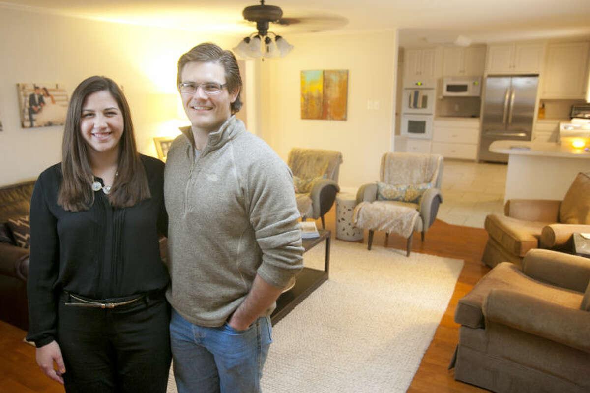 Cade and Abbie Kauffman in portrait Feb. 11, 2014 inside their Midland home. James Durbin/Reporter-Telegram