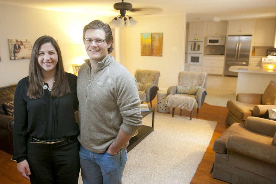 Cade and Abbie Kauffman in portrait Feb. 11, 2014 inside their Midland home. James Durbin/Reporter-Telegram Photo: JAMES DURBIN