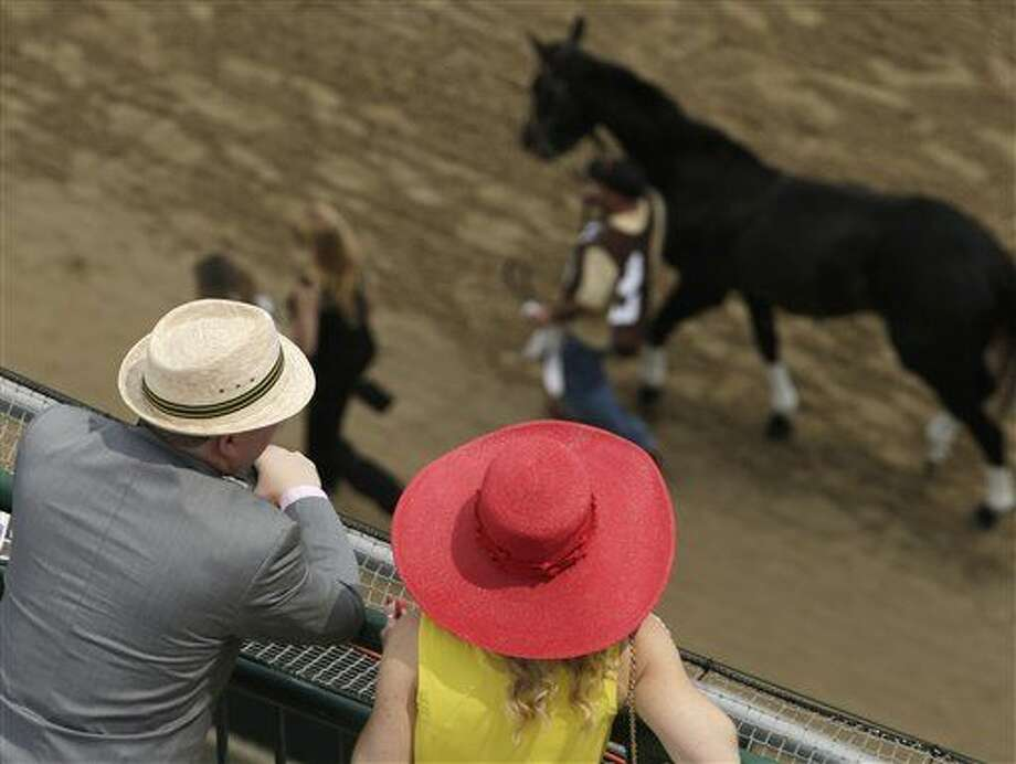 Fans watch a race before the 141st running of the Kentucky Derby horse race at Churchill Downs Saturday, May 2, 2015, in Louisville, Ky. (AP Photo/Charlie Riedel) Photo: Charlie Riedel