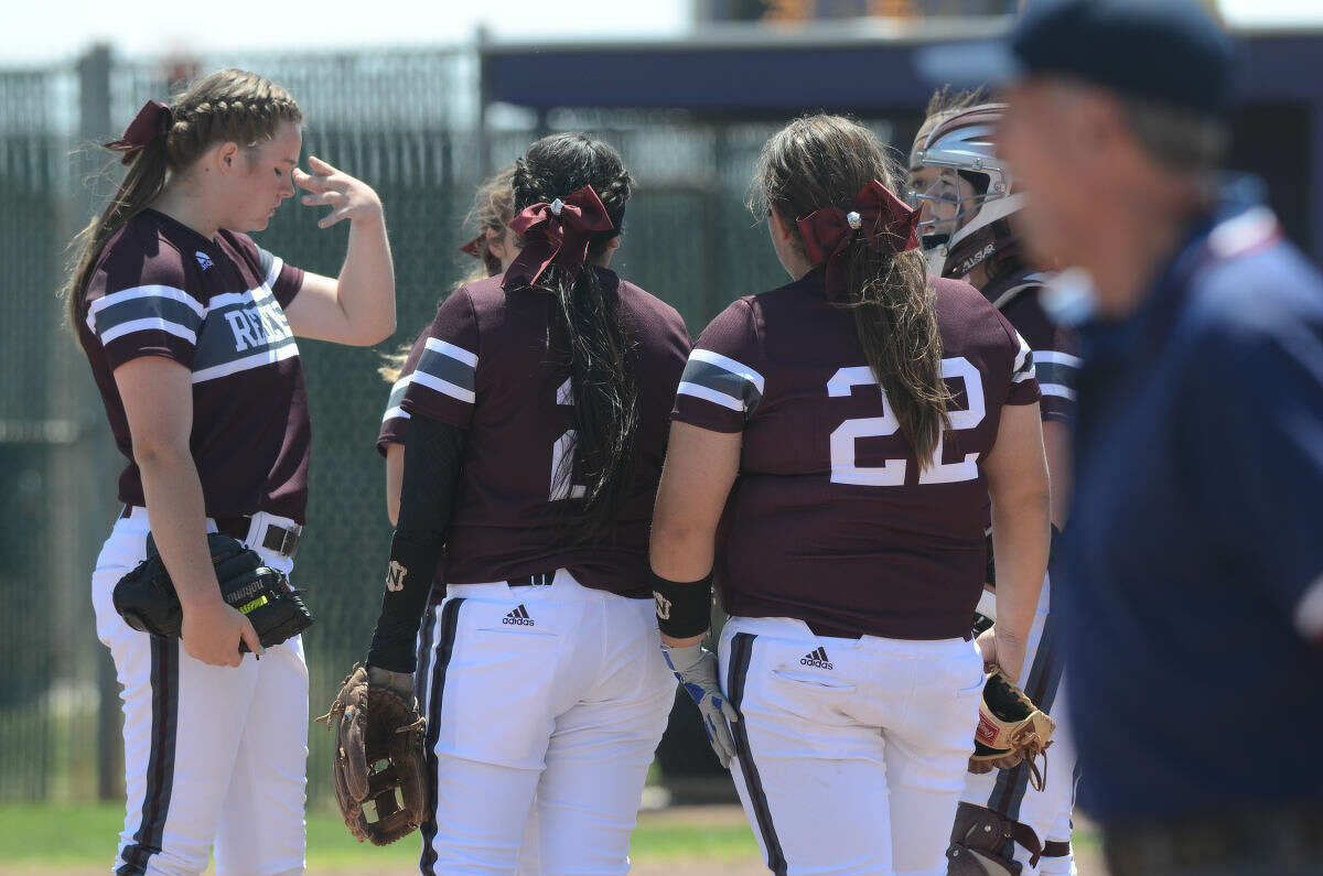 Lee High pitcher Darby O'Grady (far left) reacts to a tough inning against Midland High on Saturday, April 25, 2015, at Audrey Gill Sports Complex. James Durbin/Reporter-Telegram