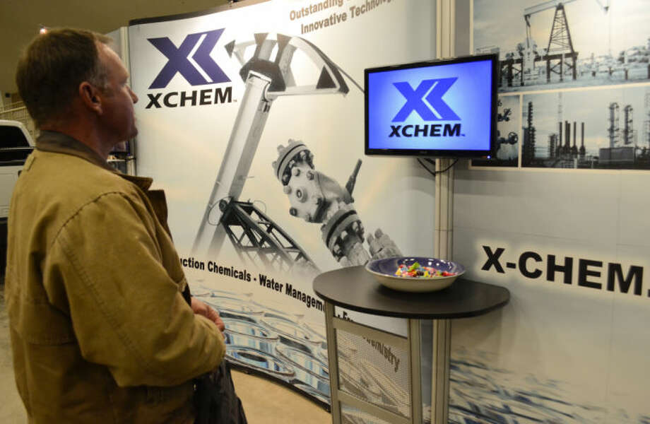 Tim Rowlins watches a video at the XCHEM booth Wednesday during the Eventures Career Fair at the Horseshoe. Tim Fischer\Reporter-Telegram Photo: Tim Fischer