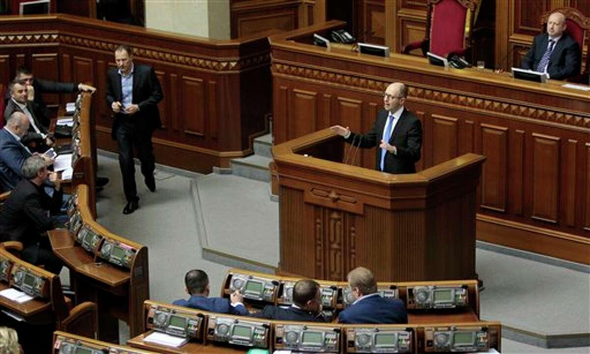 Ukrainian Prime Minister Arseniy Yatsenyuk, speaks to lawmakers during a session at the Ukrainian parliament in Kiev, Ukraine, Thursday, March. 27, 2014. (AP Photo/Sergei Chuzavkov)