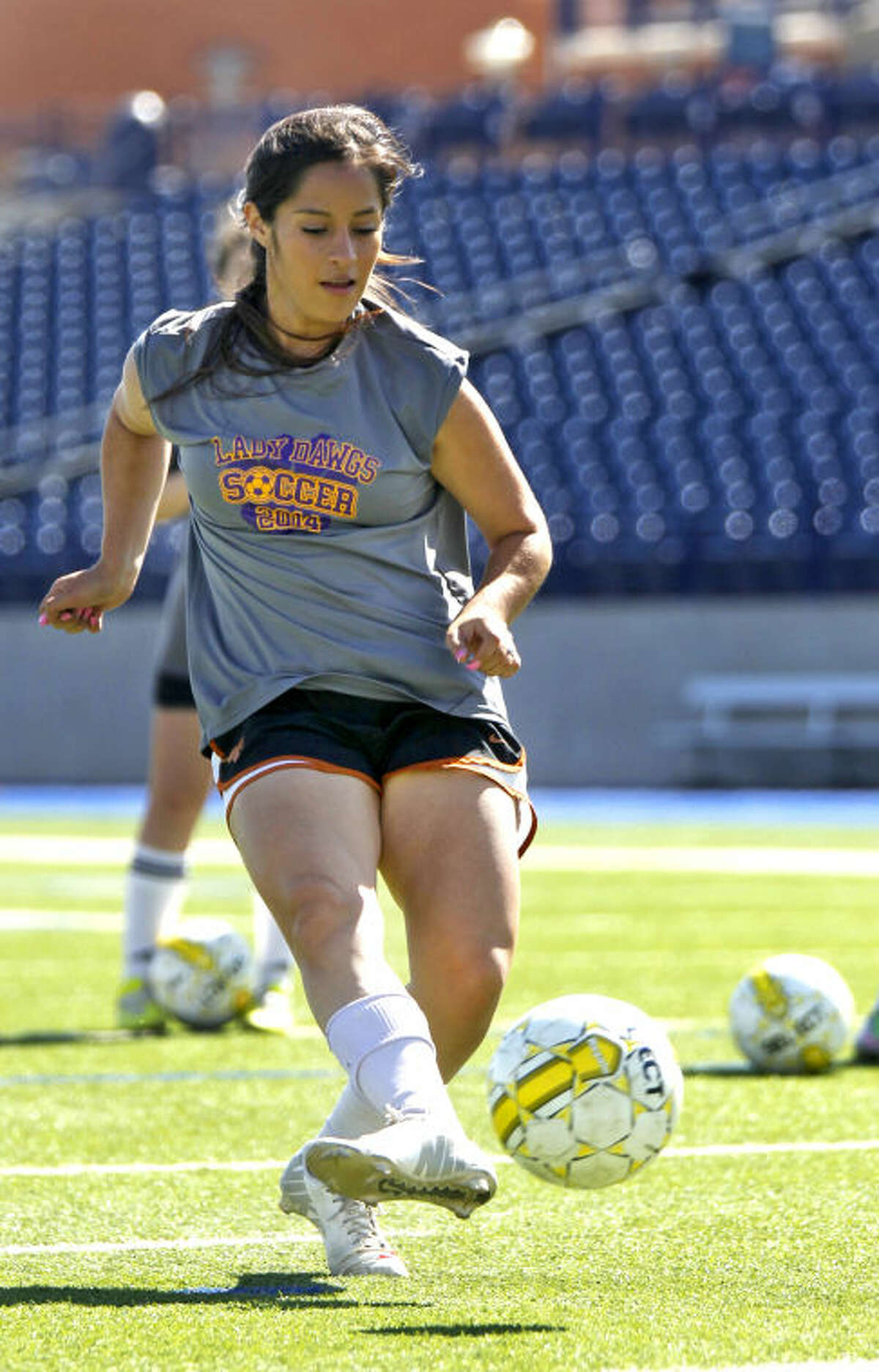 Midland High senior and girls soccer forward Selena Campos-Mancha practices a penalty kick on Wednesday at Grande Communications Stadium. James Durbin/Reporter-Telegram