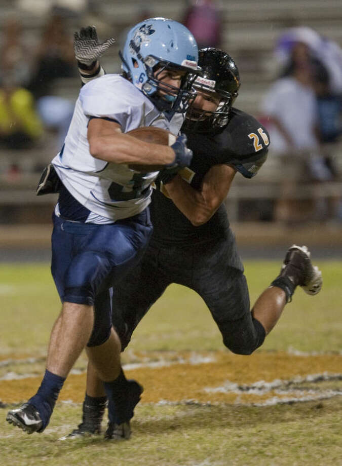 Greenwood's Dustin Rea tries to get away from Lamesa's Joseph Olvera Friday night in Lamesa. Tim Fischer\Reporter-Telegram Photo: Tim Fischer