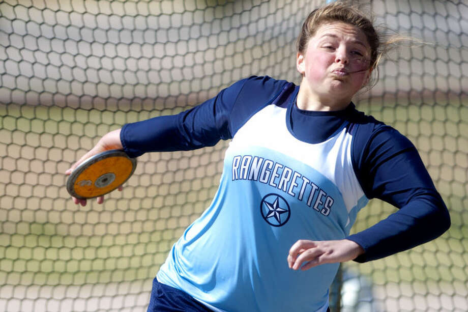 Greenwood's Amanda Bell competes in the discus event during the Greenwood Invitational on Thursday at Greenwood High. James Durbin/Reporter-Telegram Photo: JAMES DURBIN