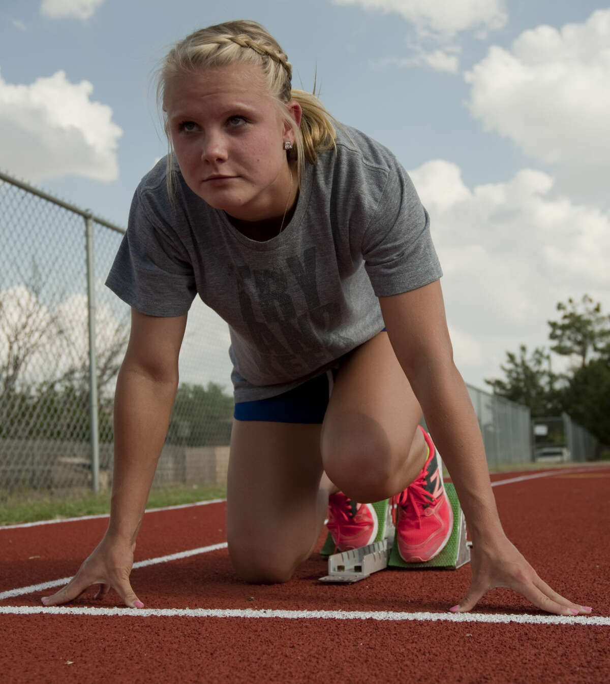 Midland Christian's Kenzi McGraw sets up on blocks Wednesday, 5-6-15, as she and others prepare for the state championship meet. Tim Fischer\Reporter-Telegram