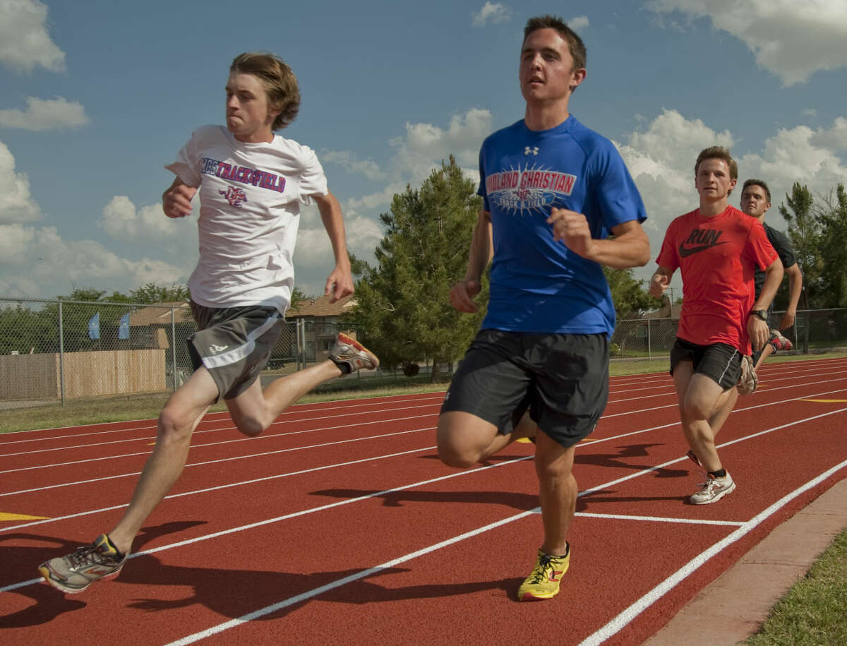 Midland Christian's Alex Causey, in blue, Adam Corbett, white shirt, Adam Suggs and Travis Causey practice passing on the corner Wednesday, 5-6-15, as they and others prepare for the state championship meet. Tim Fischer\Reporter-TelegramWednesday, 5-6-15, Tim Fischer\Reporter-Telegram