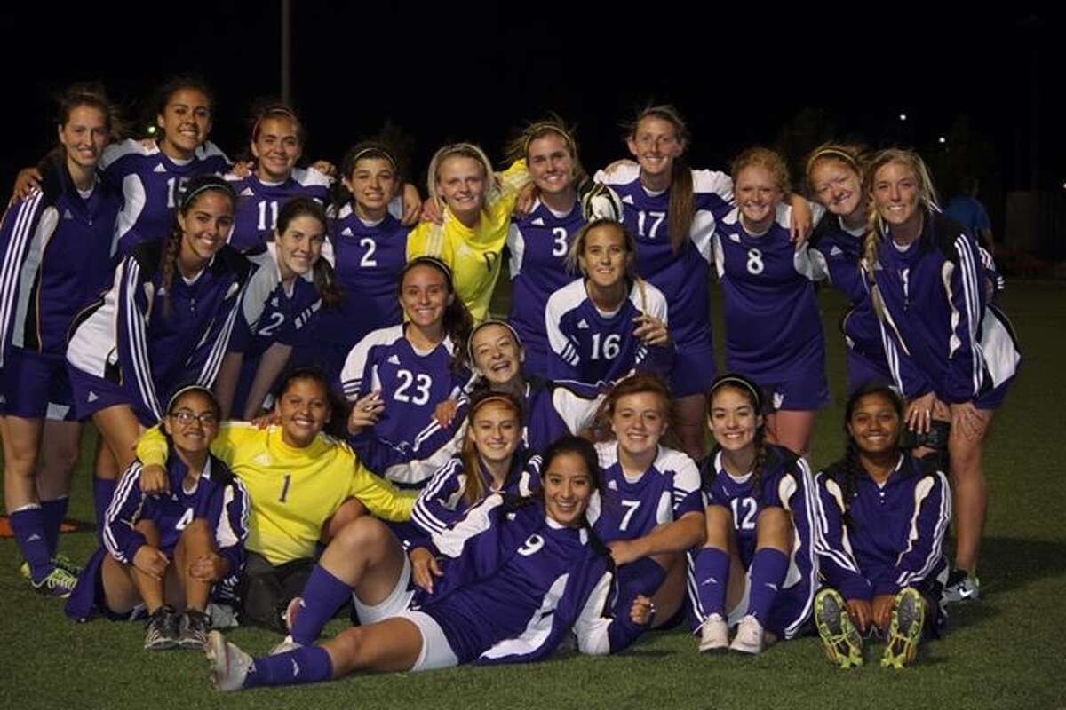 The Midland High girls soccer team gathers for a team picture after Thursday's playoff win against El Paso Coronado.