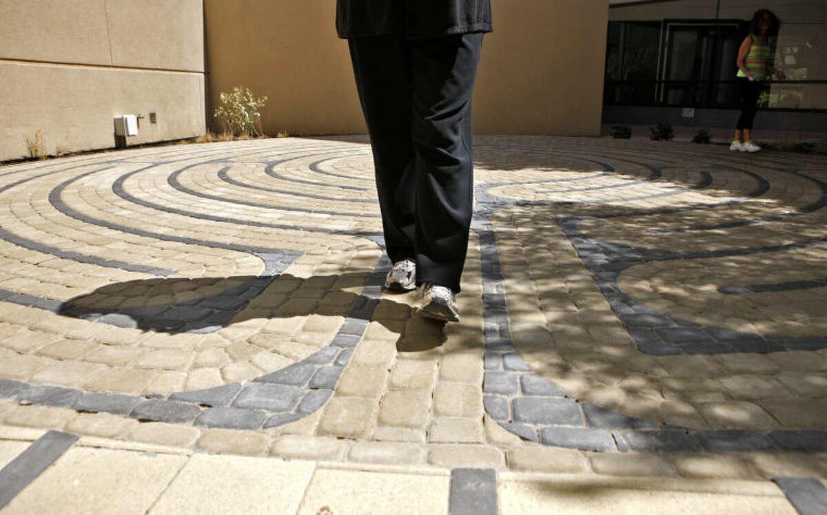 Linda Brown walks the labyrinth at Midland Memorial Hospital on Wednesday. James Durbin/Reporter-Telegram