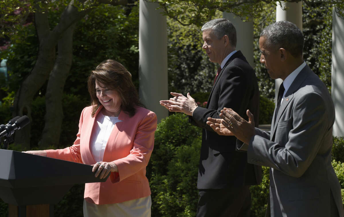 President Barack Obama and Education Secretary Arne Duncan applaud 2015 National Teacher of the Year Shanna Peeples of Amarillo, Texas, during an event to honor the 2015 National Teacher of the Year and finalists, Wednesay, April 29,2015, in the Rose Garden of the White House in Washington. (AP Photo/Susan Walsh)