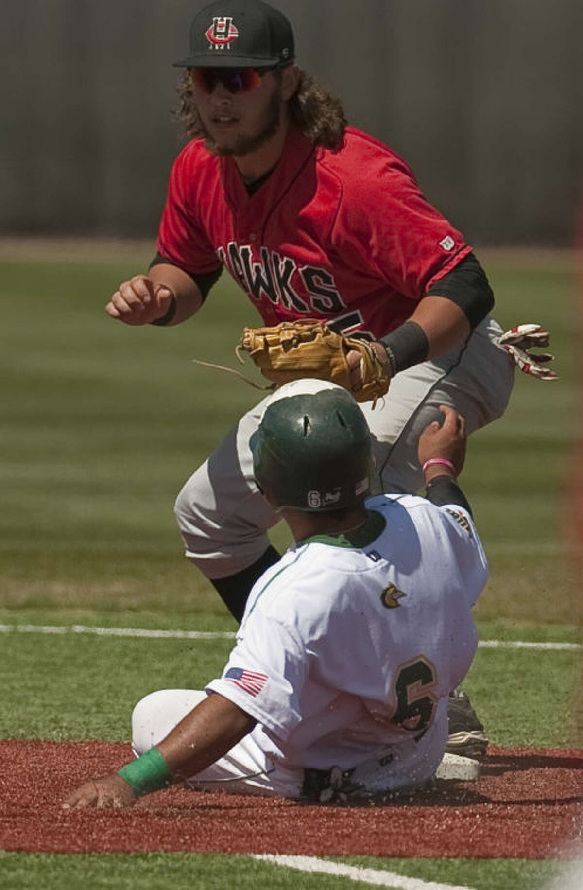 Howard College's Brandon Wagner gets the force out at second on MC's JoJo Collazo but can not complete the double play to first Friday in the first of a double header at Christensen Stadium. Tim Fischer\Reporter-Telegram