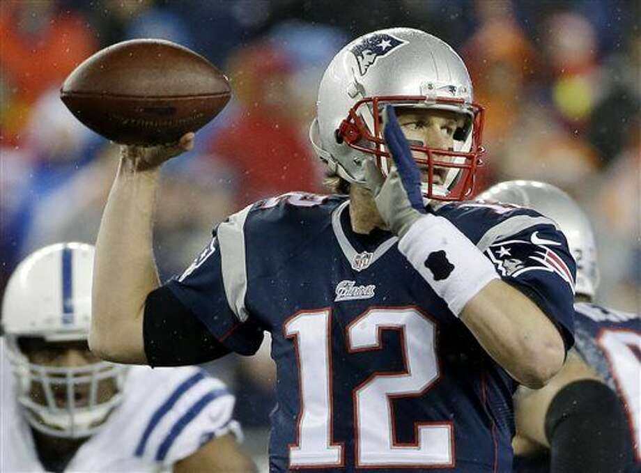 "FILE - In this Jan. 18, 2015, file photo, New England Patriots quarterback Tom Brady looks to pass during the first half of the NFL football AFC Championship game against the Indianapolis Colts in Foxborough, Mass. An NFL investigation has found that New England Patriots employees likely deflated footballs and that quarterback Tom Brady was ""at least generally aware"" of the rules violations. The 243-page report released Wednesday, May 6, 2015, said league investigators found no evidence that coach Bill Belichick and team management knew of the practice. (AP Photo/Matt Slocum, File) Photo: Matt Slocum"
