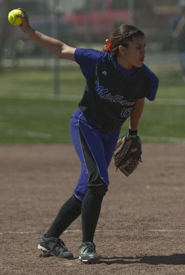Midland High's Stefani Baeza delivers a pitch Saturday against Lee High. Tim Fischer\Reporter-Telegram Photo: Tim Fischer