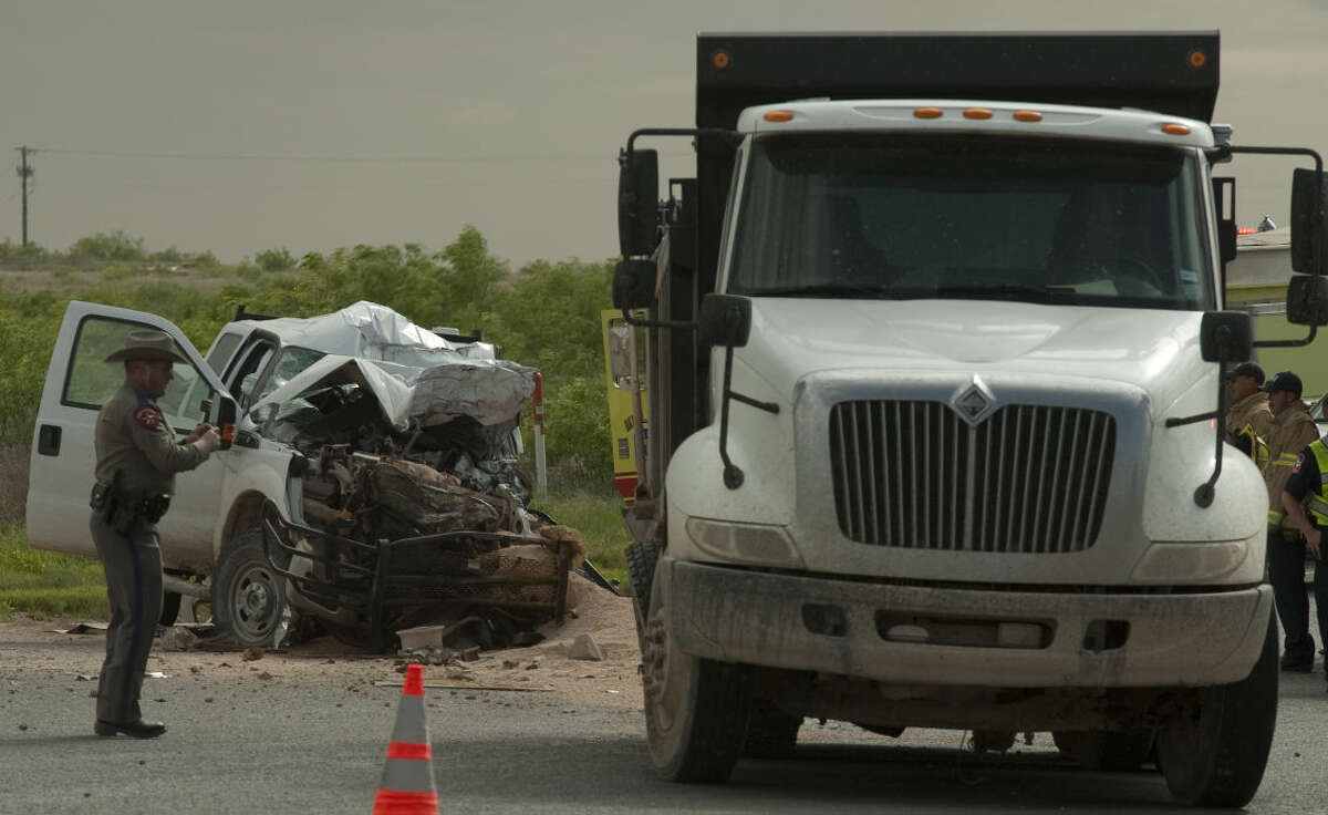 Midland fire personnel respond to a fatal accident Monday, 4-27-15, on ECR 307 and SCR 1050. Tim Fischer\Reporter-Telegram