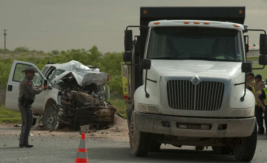 Midland fire personnel respond to a fatal accident Monday, 4-27-15, on ECR 307 and SCR 1050. Tim Fischer\Reporter-Telegram Photo: Tim Fischer