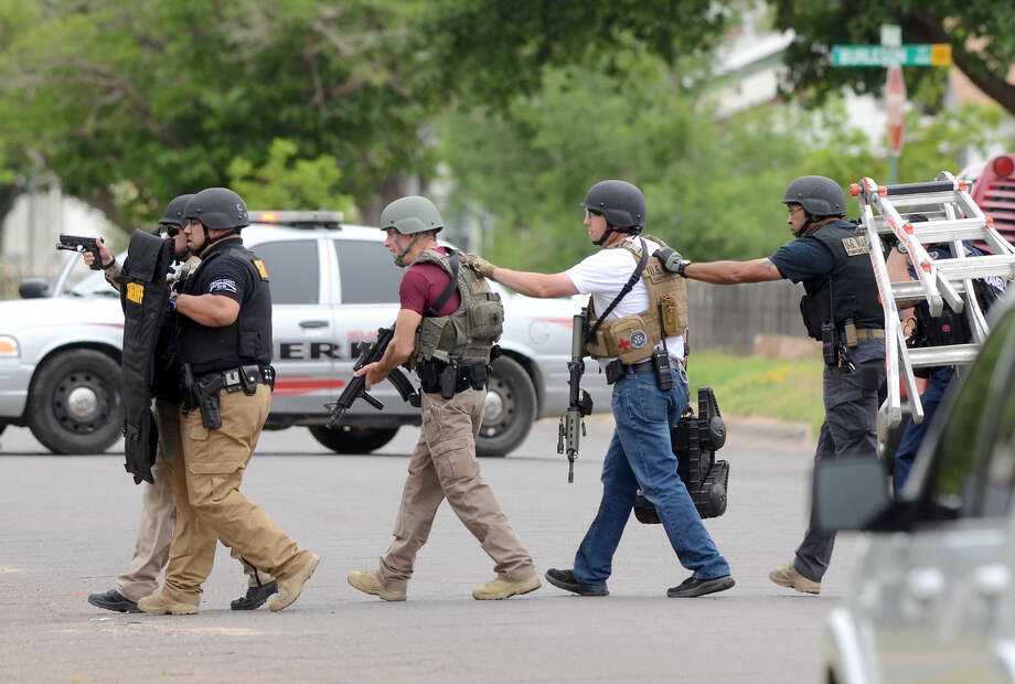 Midland public safety officials work the scene of an individual barricaded in a home on Thursday, April 23, 2015 near the intersection of Brunson and Garfield. James Durbin/Reporter-Telegram Photo: James Durbin