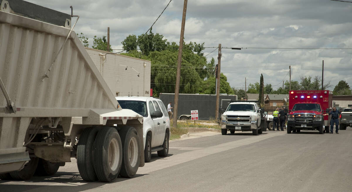 Midland police and fire respond to a person struck by a semi-truck Monday, 4-27-15, in the 1500 block of W. Industrial. Tim Fischer\Reporter-Telegram