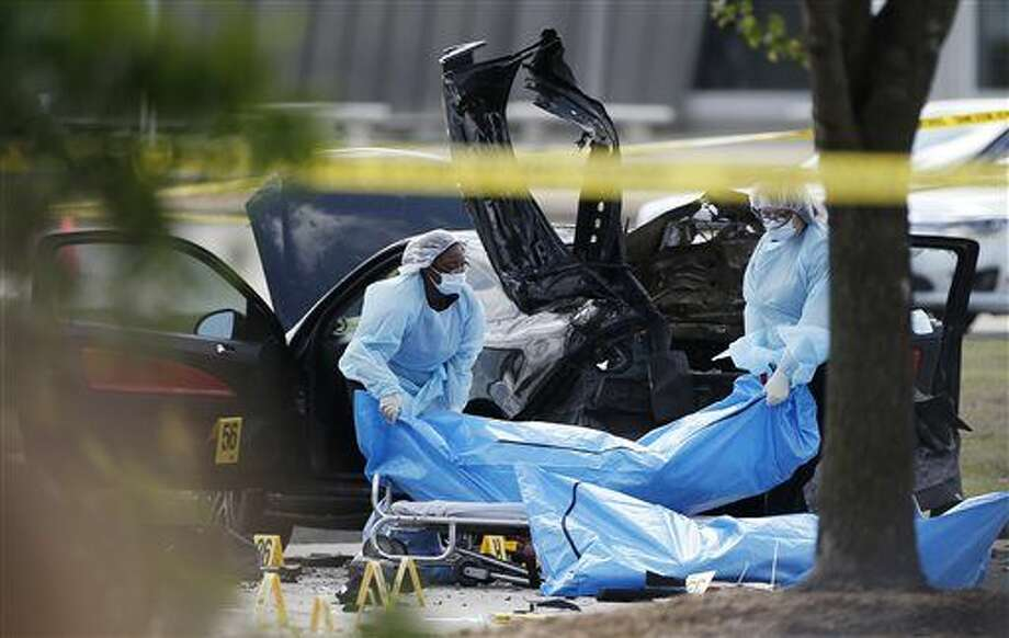 Personnel remove the bodies of two gunmen Monday, May 4, 2015, in Garland, Texas. Police shot and killed the men after they opened fire on a security officer outside the suburban Dallas venue, which was hosting provocative contest for Prophet Muhammad cartoons Sunday night, authorities said. (AP Photo/Brandon Wade) Photo: Brandon Wade