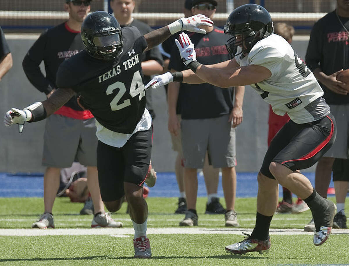 Tech's #24, Tyler Middleton gets off his block of Tech's #33 Saturday at the Texas Tech scrimmage at GRande Communications Stadium. Tim Fischer\Reporter-Telegram