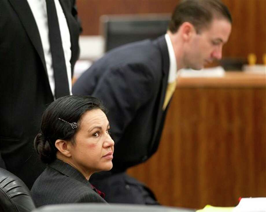 Ana Lilia Trujillo, left, sits in the courtroom before opening arguments in her trial, Monday, March 31, 2014, in Houston. Trujillo, 45, is charged with murder, accused of killing her 59-year-old boyfriend, Alf Stefan Andersson, at his Museum District high-rise condominium in June 2013. (AP Photo/Houston Chronicle, Brett Coomer) Photo: Brett Coomer / Houston Chronicle
