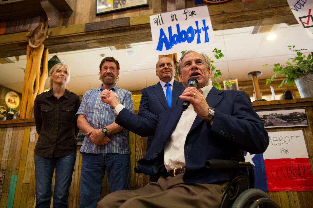 Republican gubernatorial candidate Greg Abbott points to Actor Chuck Norris Monday afternoon being introduced to him during a campaign stop at Clear Springs Restaurant in Midland.